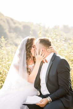 First look wedding moments, bride kisses groom and touching his face with hands Wedding Poses, Wedding Portraits, Wedding Dresses, Travel Around The World, Around The Worlds, One Sweet Day, Wedding Moments, Destination Wedding Photographer, Elegant Wedding