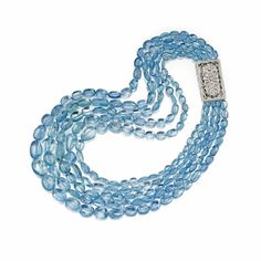 AQUAMARINE BEAD TORSADE NECKLACE Composed of five strands of tumbled aquamarine beads, completed by an openwork rectangular clasp set with numerous small round and rose-cut diamonds weighing approximately 1.10 carats, mounted in 18 karat white gold, length approximately 18 inches.