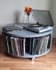 Unique reclaimed wire reel upcycled into a versatile media stand or coffee table with storage shelf.