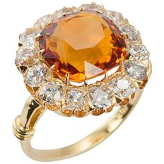 A gorgeous citrine cluster ring in 18 karat yellow gold. The citrine center stone is  surrounded by 14 Old Mine Cut diamonds which total approximately 2 carats. #CraigEvanSmall
