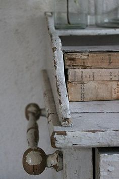 grey commode and old books