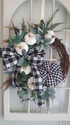 I just love this fall -halloween farmhouse wreath. Small white pumpkins,and a la. I just love this fall -halloween farmhouse wreath. Small white pumpkins,and a large stuffed gingham check pumpkin with l. Diy Fall Wreath, White Wreath, Fall Diy, Summer Wreath, Wreath Ideas, Farmhouse Fall Wreath, Farmhouse Door, Modern Farmhouse, Farmhouse Halloween