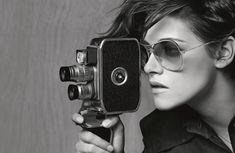 Kristen Stewart plays a photojournalist for Chanel's spring 2015 eyewear campaign.