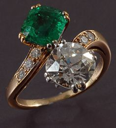 Platinum Engagement Ring with natural emerald and diamonds circa 1910