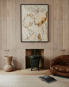 An antique Norwegian log burner sits atop a semicircle of Moroccan clay bricks in the living room. The art is by painter Faye Wei Wei.