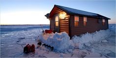 Mark Rislund's 10-by-28-foot icehouse on Mille Lacs Lake has a full kitchen, an indoor toilet, a sound system and two tv's