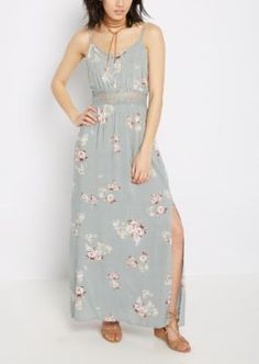 Go with the flow in this breezy maxi dress made of lightweight woven. The waistline boasts see-through crochet trim while the dress is decorated with pretty wildflower prints. Finished with a double-side split seam skirt.