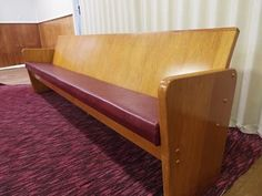 Rimu church pew with a red vinyl padded seat    These benches well constructed and well maintained.