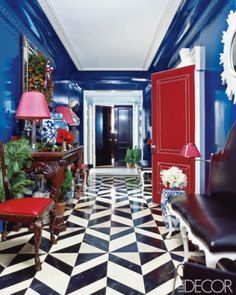 Red, white & blue entry. Walls are lacquered Yves Klein-blue.