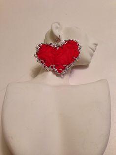A personal favorite from my Etsy shop https://www.etsy.com/listing/179016578/steampunk-heartearrings-chain-heart