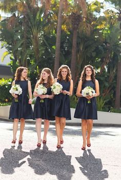 Perfect navy bridesmaid dress. Modest in front, low in back.