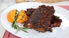 These succulent ribs, prepared with an orange chipotle BBQ sauce, are rubbed with a delightful spice combination that leaves you impressed and full. Pork Rib Recipes, Grilling Recipes, Meat Recipes, Cooking Recipes, Meat Meals, Marilyn Denis Show Recipes, Baked Ribs, Barbecue Ribs, Course Meal