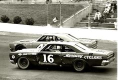 Richard Petty outside in a 1968 Plymouth Road Runner, Tinny Lund inside in Bud Moore's 1967 Mercury cyclone at the Virginia 500 at martinsville in 1968