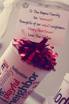 What an easy, inexpensive and thoughtful gift...words that describe the person/family wrapped around a can of hot cocoa.  Love it!