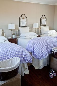 In the bedroom for her two daughters, Joyce placed three twin beds with lavender-checked bedding: one for each of them and one for visiting friends or grandmas.