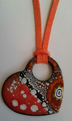 Collar de esmalte al fuego echo a mano con esmalte rojo, naranja, blanco, negro con cristal de Murano. La medida del collar es de 4.50 largo x 5 ancho. La longitud del cordón de cuero naranja es de 20cm aprox. Hadmade enamel pendant red orange black white and Murano crystal. The pendant measure 4.50 long x 4.50 wide. Length of the orange leather cord approx 20 cm. If you like a different length just let me know.