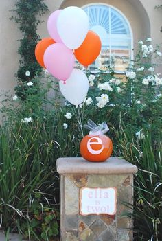 A cute way to hold down balloons at a fall themed shower or party