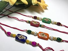 Beautiful stone rakhi with different colors comes with roli and chawal Handmade Jewelry Designs, Handmade Necklaces, Diy Bracelets Easy, Beaded Bracelets, Handmade Rakhi Designs, Rakhi Making, Rakhi Gifts, Best Gifts For Men, Jewelry Patterns