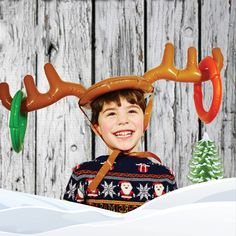 Let's play Christmas Reindeer games! You throw 2 red and 2 green round rings onto the large Reindeer Antlers on your friend's head!Take turns wearing the antlers and make your own games. Great fun for your holiday party. It's funny and fun to play. Buy several and give them as party favors or Stocking Stuffers!