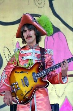 Beatles: George Harrison with the Sgt. Peppers Lonely Hearts Club Band... we hope you…