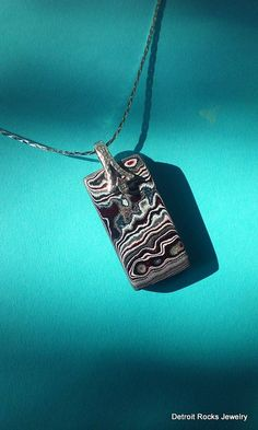 Reversible Detroit Fordite Agate Necklace Pendant on Solid Sterling Silver Bail by DetroitRocksJewelry on Etsy