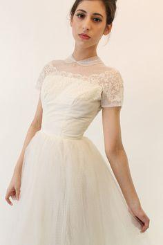 Love this swiss dot and dainty peterpan collar wedding dress.