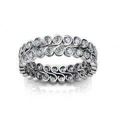 Eternity Band - LA-50    Round cut brilliant diamonds; swirl, twist and whirl this eternity band has a theatrical presents which in turn has a unique style, to be worn with confidence.