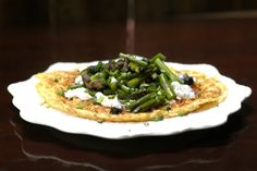 Asparagus Omelet: Every weekend at the farmers' market, my first purchase is a large bunch of asparagus. I cook it several different ways, roasted, on top of a savory tart, sauteed and even shaved in a raw salad. If you're a devotee of these green spears, then you don't need convincing that asparagus will taste great on top of a goat cheese omelet.