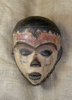 This African Mask from the Pende tribe of the Democratic Republic of Congo measures 12 inches tall and is hand-carved of wood. This example ...