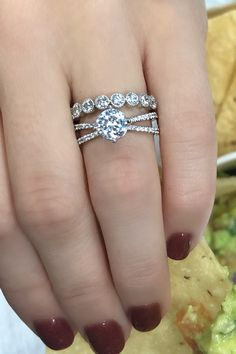 Round diamond engagement ring with an open space split shank and a bezel set wedding band #splitshank #split #rounddiamond #engagementring #bezel #weddingband #milgrain #engagementrings