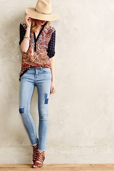Anthro Spring/Summer outfit: straw hat or fedora, paisley printed button up, light wash denim and strappy sandals