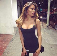 Skinny brunette model. Tight little black dress.