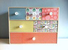 Ikea Moppe unit pimped.Covered with decorative paper & drawer knobs added