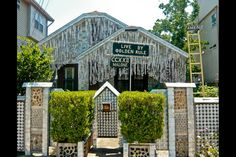 """House with walls made of empty beer cans  The """"Beer Can House"""" in Houston is a project started in 1968 by John Milkovisch, a retired upholsterer for the Southern Pacific Railroad. It has more than 50,000 cans on its facade."""
