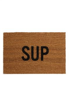 Welcome visitors with this cool, casual doormat featuring natural coconut-fiber bristles.