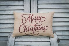 **PLEASE read the storefront message of our etsy shop for important updates and current processing times BEFORE ordering. Message us with any custom requests BEFORE ordering as well. Thank you.  Have a very Merry Christmas this upcoming holiday season with a small decor pillow to accent your chair, couch, and/or beds.  This handmade pillow comes in size 14x9 from seam to seam. Choose your material from Natural Burlap (as shown), Ivory Burlap, Dark Beige Burlap, Sage Burlap, White Woven…