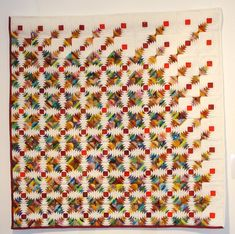 Pineapple quilt - I like the idea of a block blowing pieces away till it's just the center square!  Maybe try with a log cabin block?