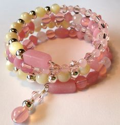 Welcome to TeamUNITY  by Cheryl  Please come check out my item--Pink stretch charm bracelet here on Etsy