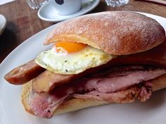 Frühstück Burger at St Ali in South Melbourne. Bacon, cheese kransky sausage and fried egg in a bun.
