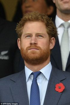 Family affair: Prince Harry and Prince Philip were dressed for the occasion as they joined tens of thousands of rugby founds inside the ground