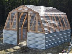 Free step by step plans to build a barn style greenhouse!...From Ana White...