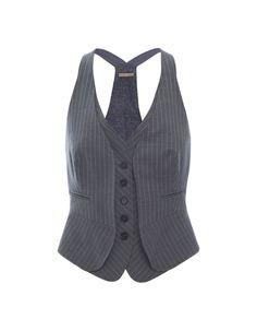 Formal wear reminds me of career driven women  http://www.julesb.co.uk/womenswear-2/womens-designer-tops-24/stripe-fitted-waistcoat-360653-25298_zoom.jpg