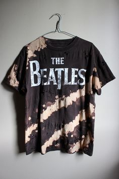 This shirt is a one of a kind, each splattered shirt is different. This one is a Beatles tee , all cotton. Splatter bleach and shredded all over.