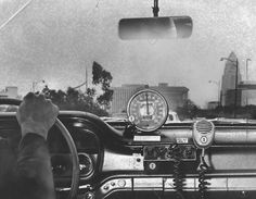 """""""Interior view of a Los Angeles Police Department freeway interceptor car with a special speedometer on the dashboard, a police radio which not only communicates with downtown headquarters but also listens to other cars' broadcasts on his channel, and microphone.""""  - L.A. Herald-Examiner, 1961"""