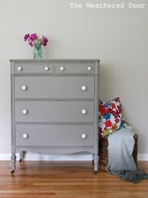 The Weathered Door: A distressed elephant grey dresser with white knobs. Paint: Elephant Skin by Behr