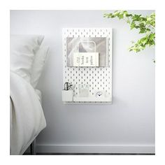 Ikea Skadis pegboard- amazing as a nightstand!
