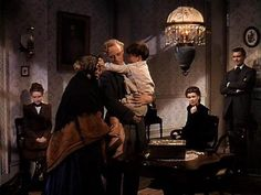 "Leslie Howard as Ashley Wilkes, Mickey Kuhn as Beau Wilkes in ""Gone With the Wind"" (1939)"
