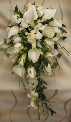 One of my all time favourites! classic calla and rose shower bouquet with grass and diamante detail. Lily Bouquet Wedding, Cascading Wedding Bouquets, Wedding Cake Fresh Flowers, Calla Lily Bouquet, Cascade Bouquet, Wedding Flower Arrangements, Bride Bouquets, Bridal Flowers, Floral Bouquets