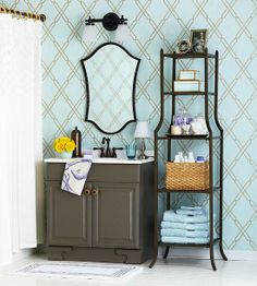 Towering Storage: Fill a narrow sliver of space next to a vanity with a slender etagere. Because these units often come with multiple shelves, they offer more storage real estate, even within a confined space.