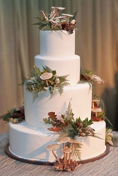 Aspen Woodlands Wedding Cake. A woodland scene of marzipan mushrooms and fresh ferns and berries is the perfect complement to a wedding celebration in Aspen.